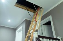 ladder into attic space in home