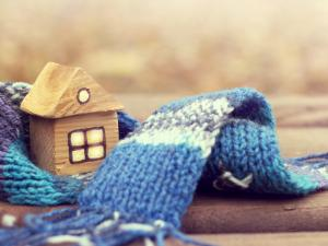 home model with scarf around it, warm home concept