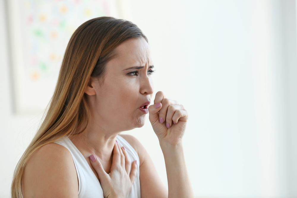 woman coughing at home, poor iaq
