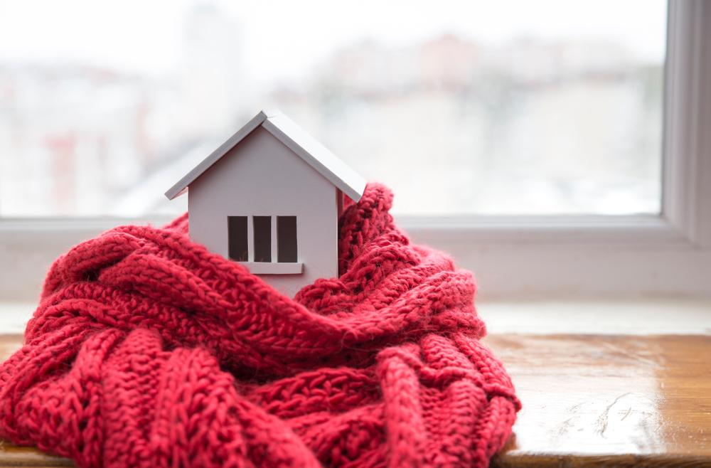 house model wrapped in scarf, cold home